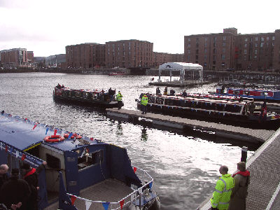 The flotilla of boats arrives at Salthouse Dock.