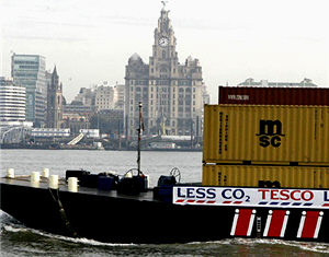 One of the new barges passing Liverpool's waterfront.