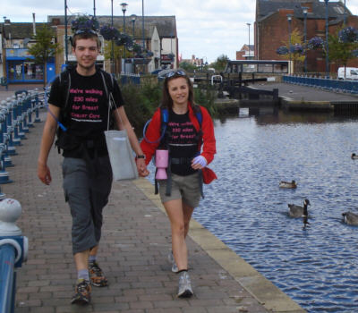 Richard Hakier and Rebecca Sellens stride through Stalybridge on the last day of their walk.